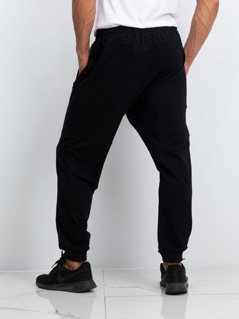 TOMMY LIFE Czarne dresy męskie plus size                              zdj.                              2