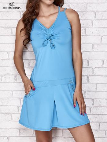 Turkusowa sukienka sportowa z wiązaniem przy dekolcie