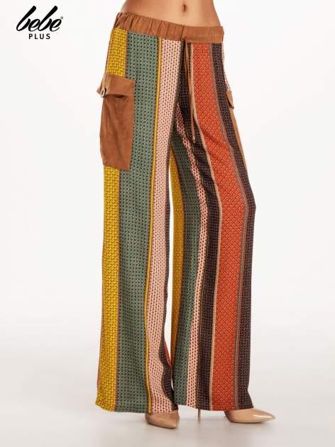 Wzorzyste spodnie palazzo z kieszeniami                                  zdj.                                  1