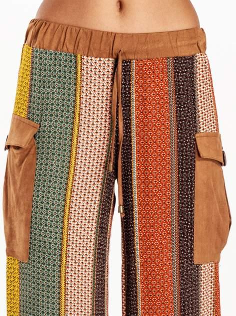 Wzorzyste spodnie palazzo z kieszeniami                              zdj.                              7