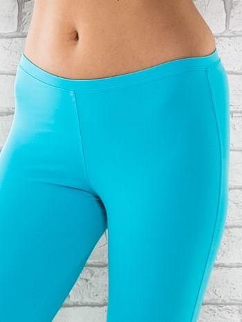 Zielone legginsy sportowe termalne z dżetami na nogawkach                                  zdj.                                  4