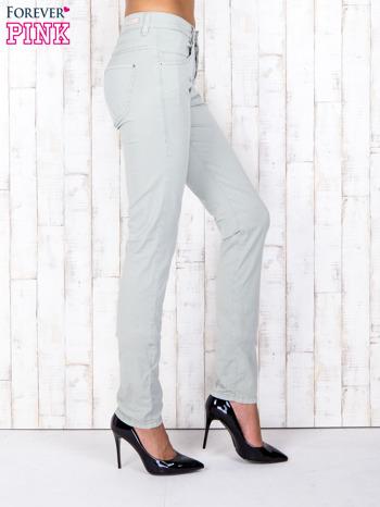 Zielone materiałowe spodnie regular na guziki                                  zdj.                                  2
