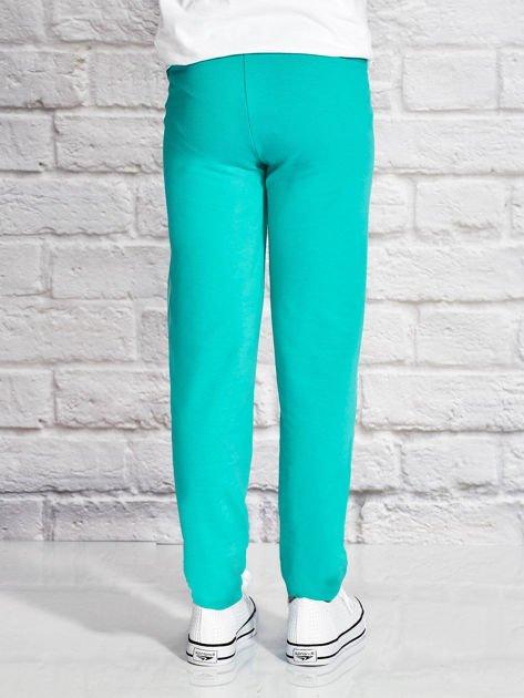 Zielone spodnie dresowe dla dziewczynki SUPER GIRL                              zdj.                              2