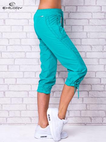 Zielone spodnie sportowe capri z siateczką                                  zdj.                                  2