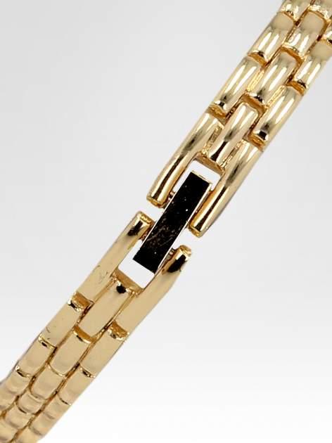Złoty zegarek biżuteryjny z granatową tarczą i cyrkoniami                                  zdj.                                  4