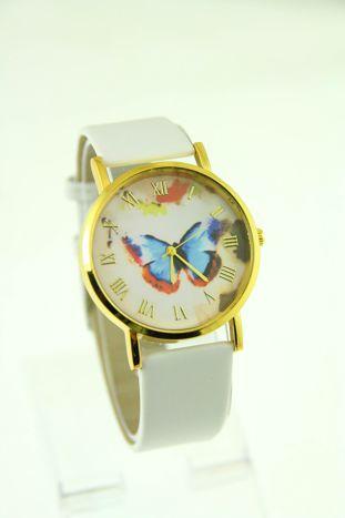 Złoty zegarek damski na białym pasku
