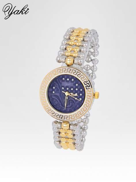 Złoty zegarek na bransolecie z grawerem wokół granatowej tarczy                                  zdj.                                  2