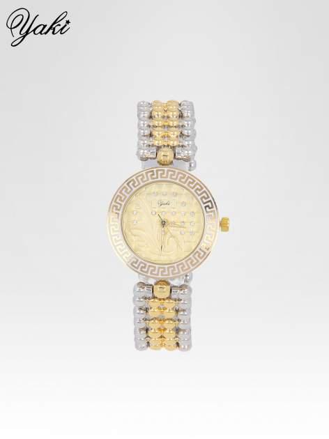 Złoty zegarek na bransolecie z grawerem wokół złotej tarczy                                  zdj.                                  1