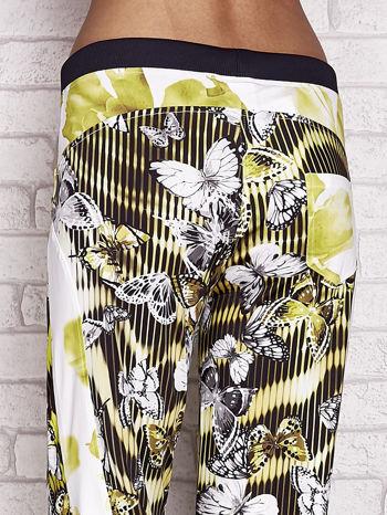 Żółte spodnie capri z nadrukiem motyli                                  zdj.                                  5