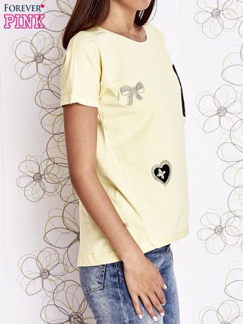 Żółty t-shirt z motywem serca i kokardki                                  zdj.                                  3