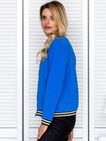 Bluza damska z błyszczącym ściągaczem niebieska                                  zdj.                                  5