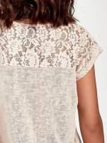 Brzoskwiniowy t-shirt z koronkowymi rękawami i gwiazdkami                                                                          zdj.                                                                         6