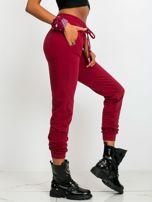 Ciemnoczerwone spodnie Faster                                  zdj.                                  3