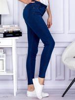 Ciemnoniebieskie spodnie jeansowe slim z wysokim stanem                                  zdj.                                  5