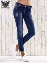 Ciemnoniebieskie spodnie skinny jeans ze złotymi ćwiekami                                  zdj.                                  1