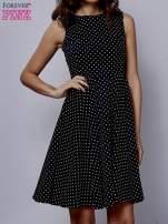 Czarna rozkloszowana sukienka w groszki