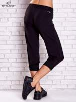Czarne spodnie capri z dżetami i lampasami PLUS SIZE                                  zdj.                                  2