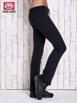 Czarne spodnie dresowe z brokatową naszywką