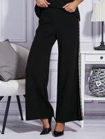 Czarne spodnie z cekinowym lampasem                                  zdj.                                  1