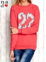 Czerwona bluza z cyfrą 27                                  zdj.                                  1