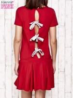 Biała sukienka dresowa z kokardami z tyłu                                                                          zdj.                                                                         4