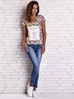 Fioletowy t-shirt w kwiaty z napisem BEFORE I EVER MET YOU