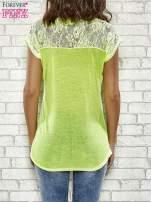 Fluożółty t-shirt z napisem IF IT DOESN'T BREAK YOUR HEART IT ISN'T LOVE                                  zdj.                                  2