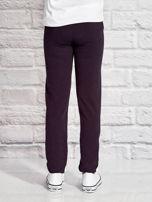 Grafitowe spodnie dresowe dla dziewczynki z flamingiem                                  zdj.                                  2