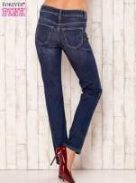 Granatowe proste spodnie jeansowe