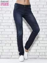 Granatowe spodnie skinny jeans biker z przeszyciami                                  zdj.                                  1