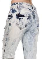Jasnoniebieskie rozjaśniane spodnie jeansowe z przetarciami                                  zdj.                                  6