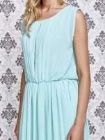 Miętowa grecka sukienka maxi z koronką z tyłu