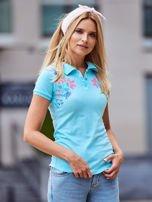 Miętowa koszulka polo z kolorowym kwiatowym printem                                  zdj.                                  1