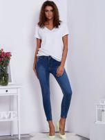 Niebieskie jeansowe rurki ze stretchem                                  zdj.                                  4