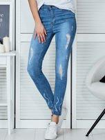 Niebieskie jeansowe spodnie skinny z koronkowymi wstawkami                                  zdj.                                  1