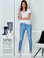 Niebieskie jeansy vintage o dopasowanym kroju                                  zdj.                                  4