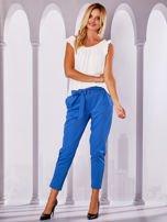 Niebieskie materiałowe spodnie z wiązaniem                                  zdj.                                  4