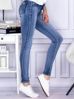 Niebieskie rozjaśniane jeansy rurki PLUS SIZE                                  zdj.                                  5