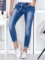 Niebieskie spodnie jeansowe damskie z ozdobnym suwakiem PLUS SIZE                                  zdj.                                  1
