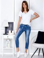 Niebieskie spodnie jeansowe damskie z ozdobnym suwakiem                                  zdj.                                  4
