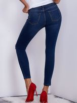 Niebieskie spodnie jeansowe skinny z przedarciami                                   zdj.                                  2