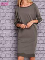 Oliwkowa sukienka oversize ze ściągaczem                                  zdj.                                  1