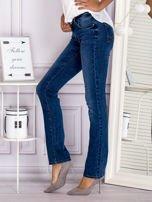 Proste spodnie jeansowe z delikatnymi przetarciami niebieskie                                  zdj.                                  6