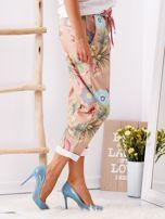Beżowe spodnie w kwiaty                                  zdj.                                  3