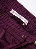 STRADIVARIUS Burgundowe spodnie z lejącej tkaniny z kieszeniami                                  zdj.                                  3