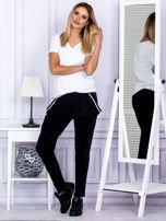 Spodnie damskie dresowe ze ściągaczami czarne                                  zdj.                                  4
