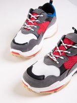 Szare buty sportowe z kolorowymi sznurówkami i czerwoną wstawka na podeszwie                                  zdj.                                  4